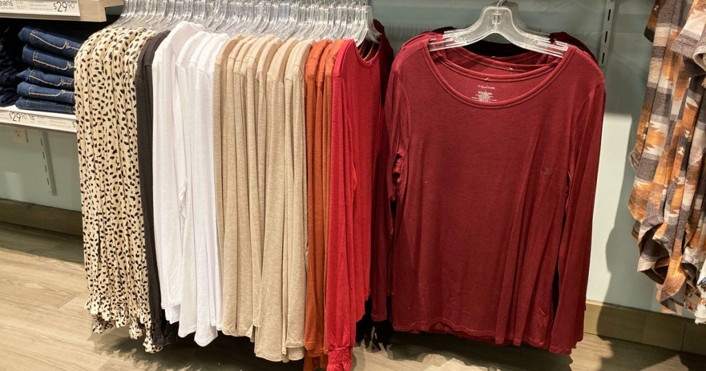 various colors of women's long sleeve tees on hangers at Maurice's