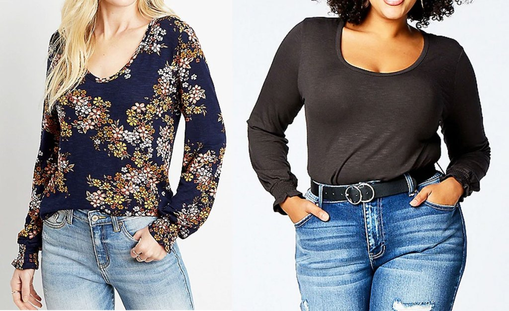 two women modeling long sleeve tees in navy blue with floral print and black with cuffed sleeves