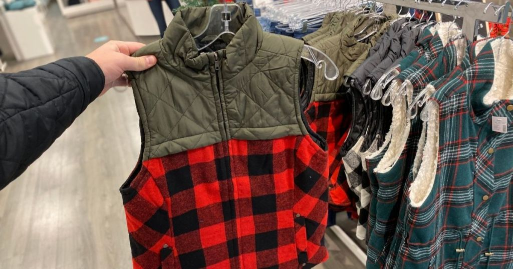 hand holding a Maurices vest on a hanger