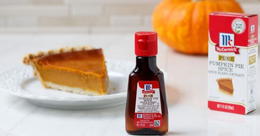 McCormick Pure Pumpkin Pie Spice Extract on table with pie in background