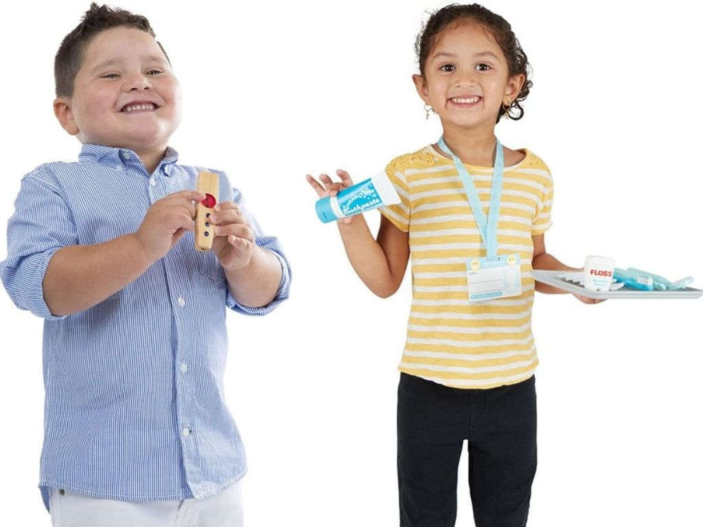 Boy and Girl playing with Melissa & Doug Toys