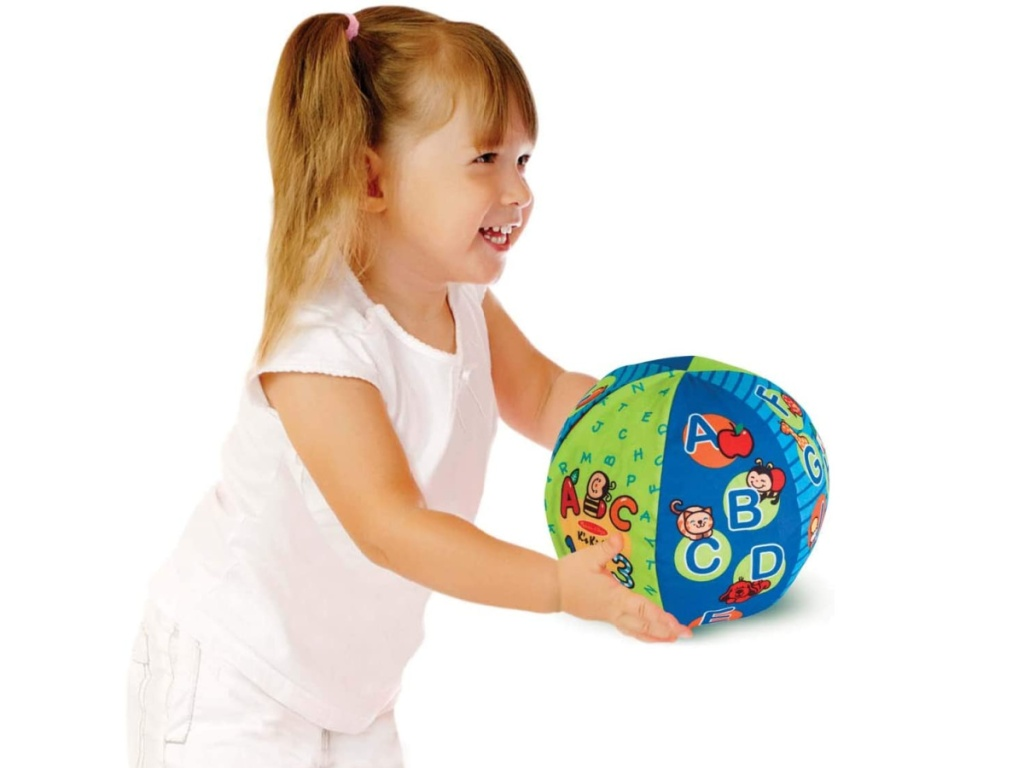little girl playing with a melissa and doug 2 in 1 ball