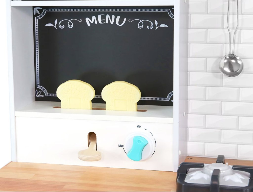 wooden kids kitchen playset with toaster with two pieces of bread and a chalkboard menu board