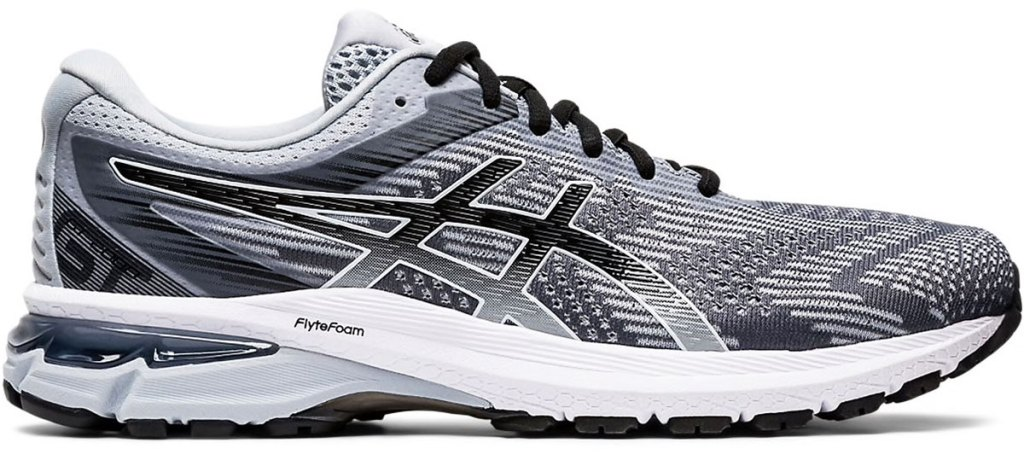 grey and black mesh running shoe with white foam sole