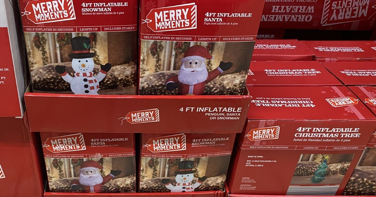 boxes of Christmas inflatables on display at ALDI