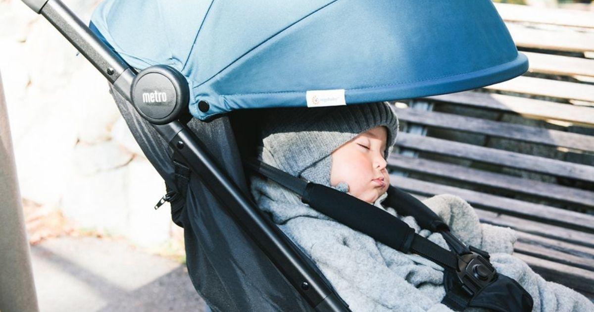 baby boy asleep in a stroller