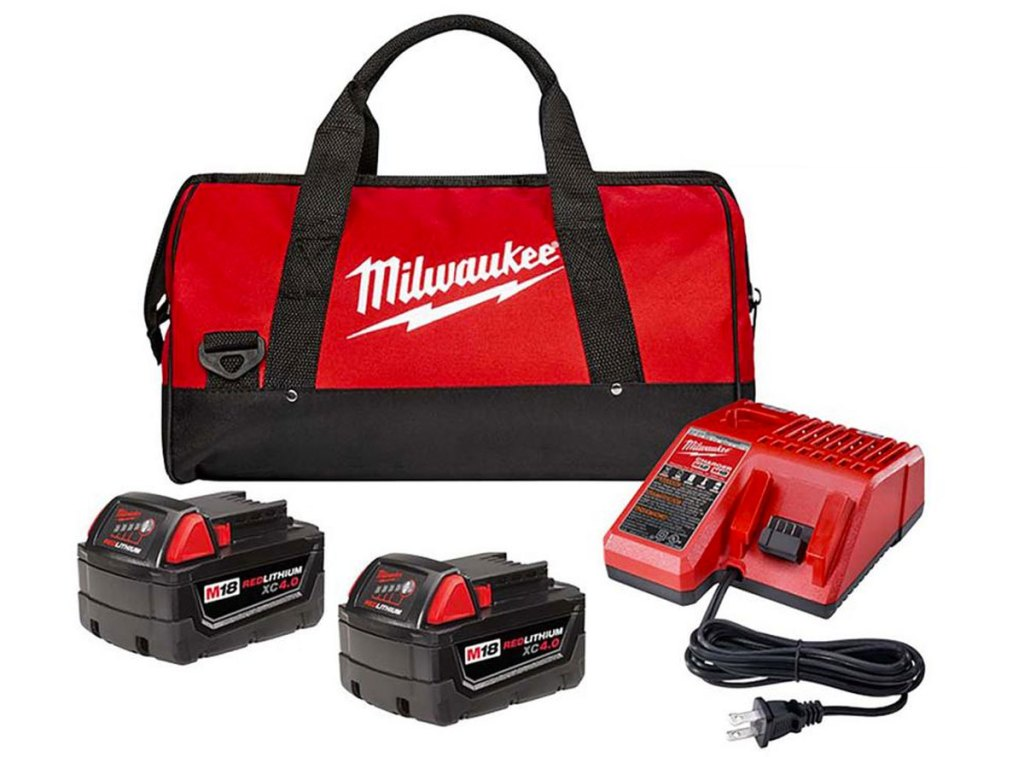 two red and black milwaukee batteries, a charger, and a tool bag