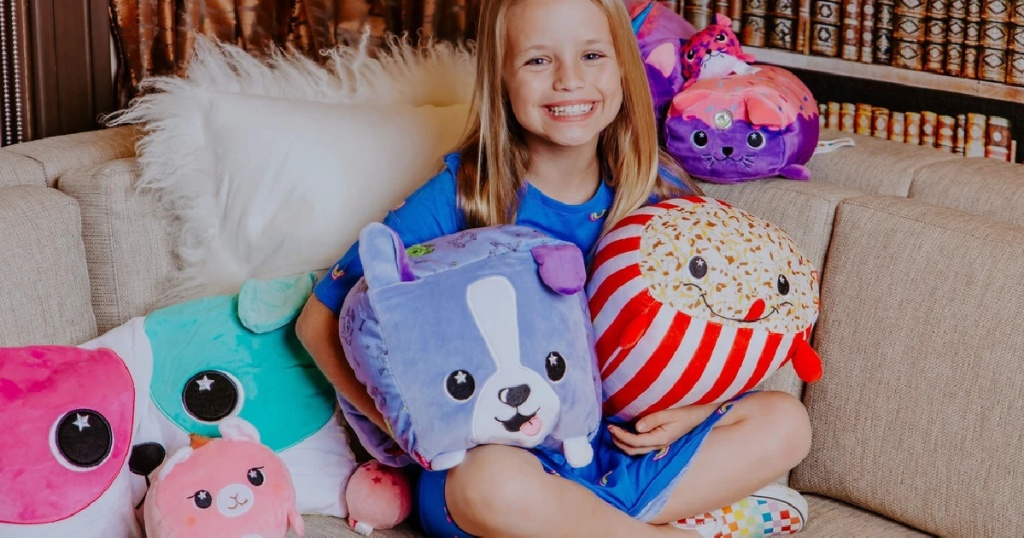 girl on couch with plush pillow toys