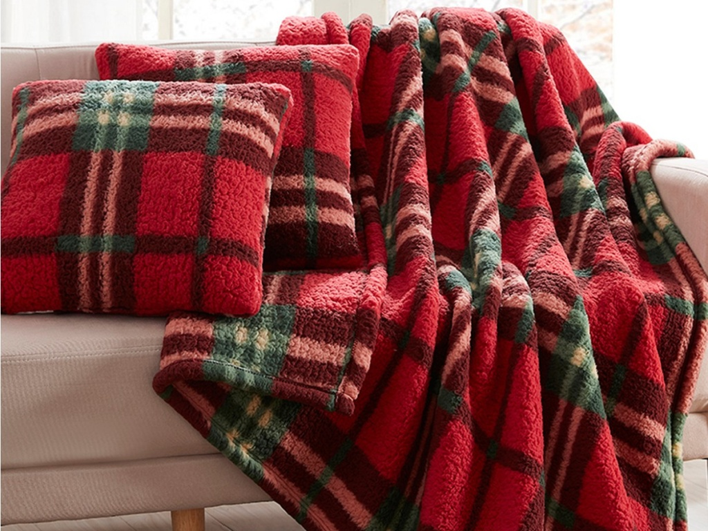 red plaid blanket and pillow set on couch