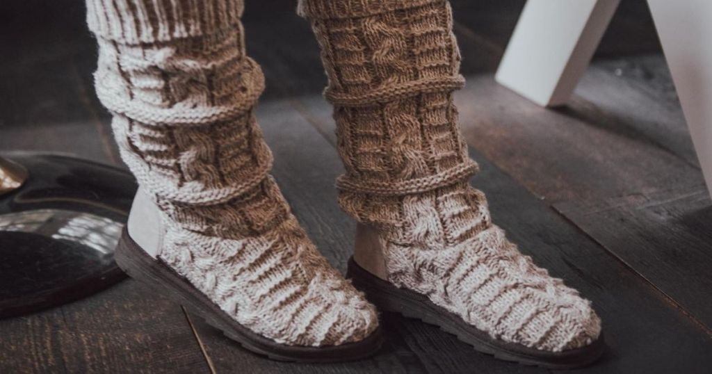person wearing a pair of Muk Luks boots