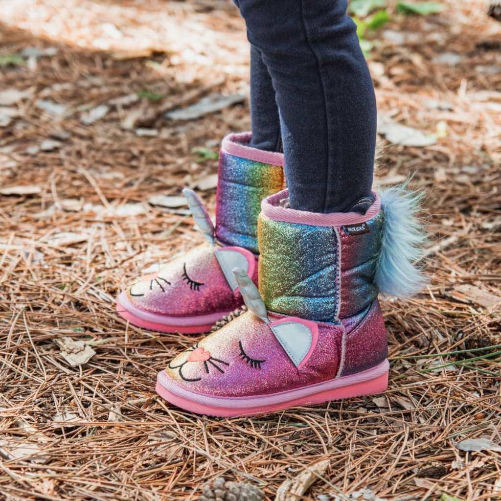 girl wearing Muk Luks Zoo Boots