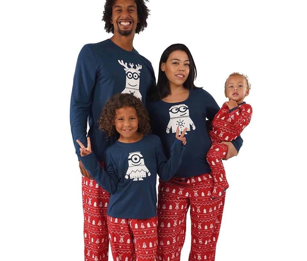 family wearing matching Minions pajamas