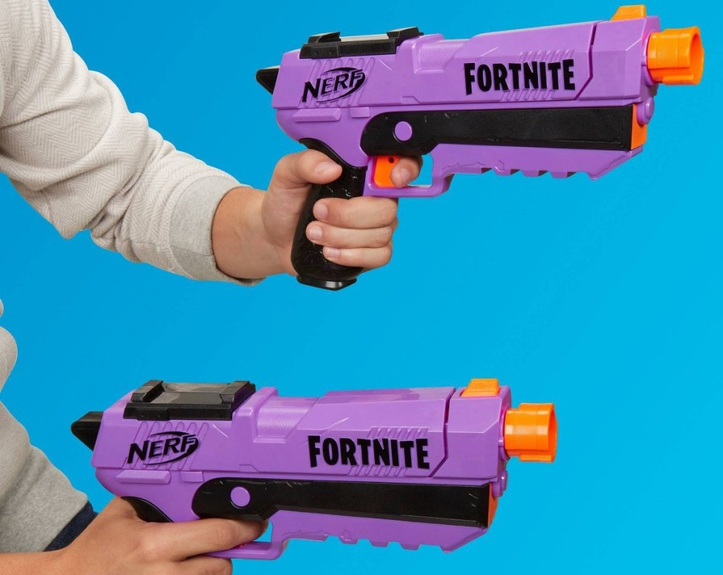 hands holding NERF Blasters