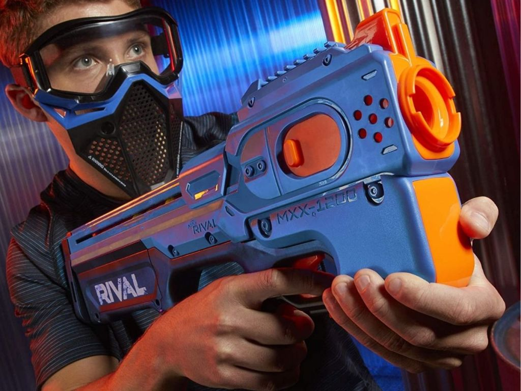 boy aiming NERF rival
