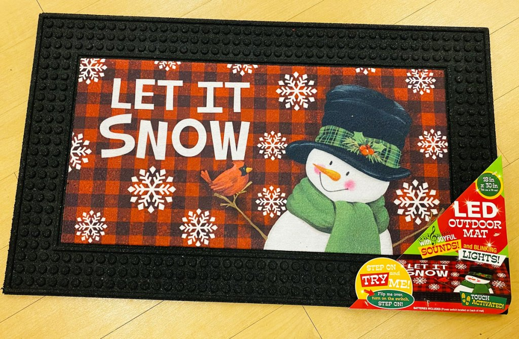 red buffalo plaid doormat with snowman that says let it snow on a wood floor at kohl's