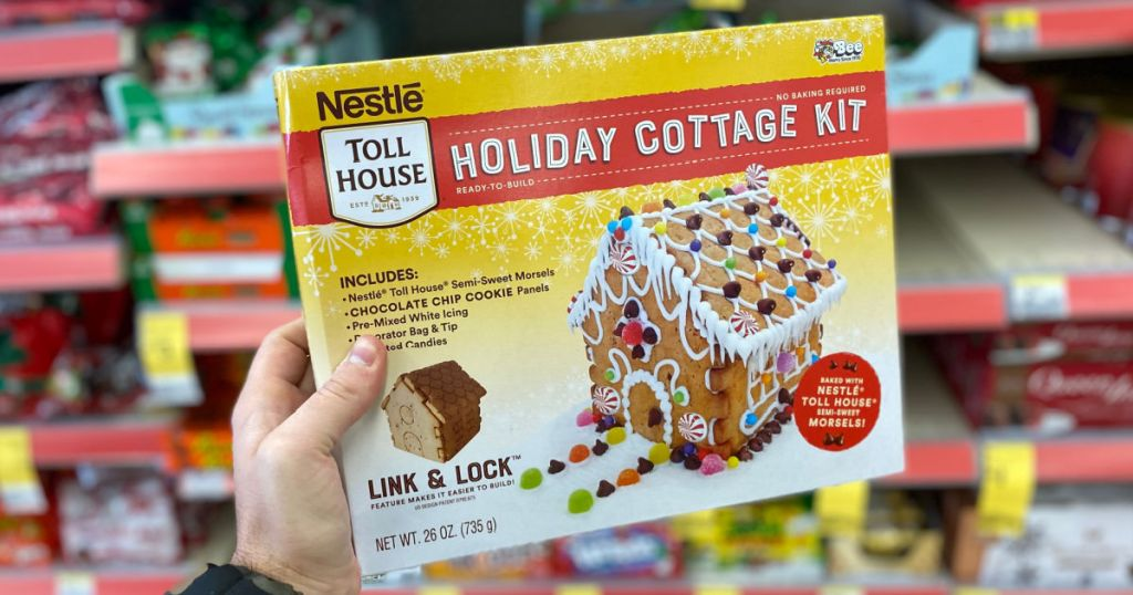 hand holding gingerbread house