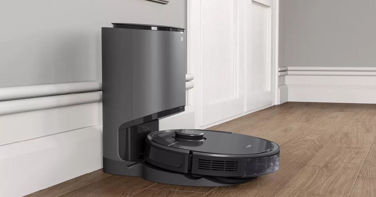 robotic vacuum and auto waste removal on floor