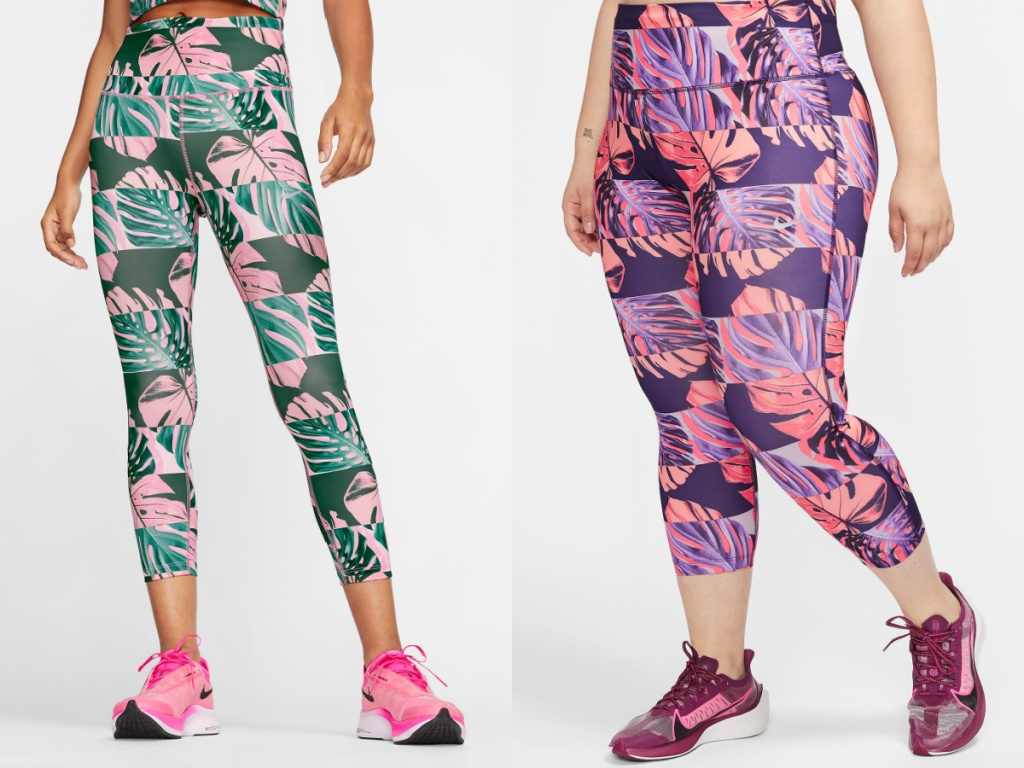 woman in green and pink tropical print leggings and woman in pink and purple tropical print leggings