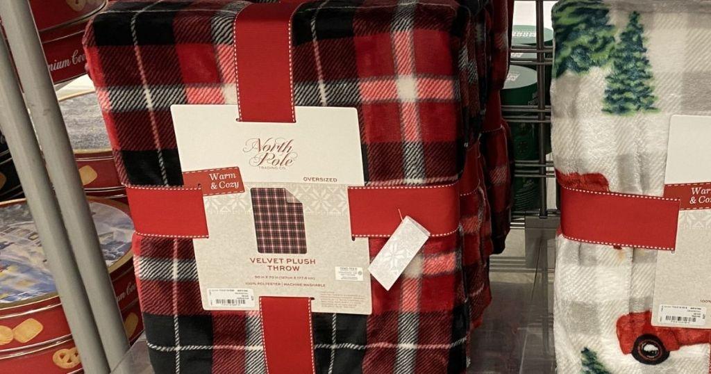 plaid blanket on a shelf