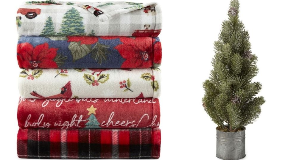 stack of blankets and faux tree