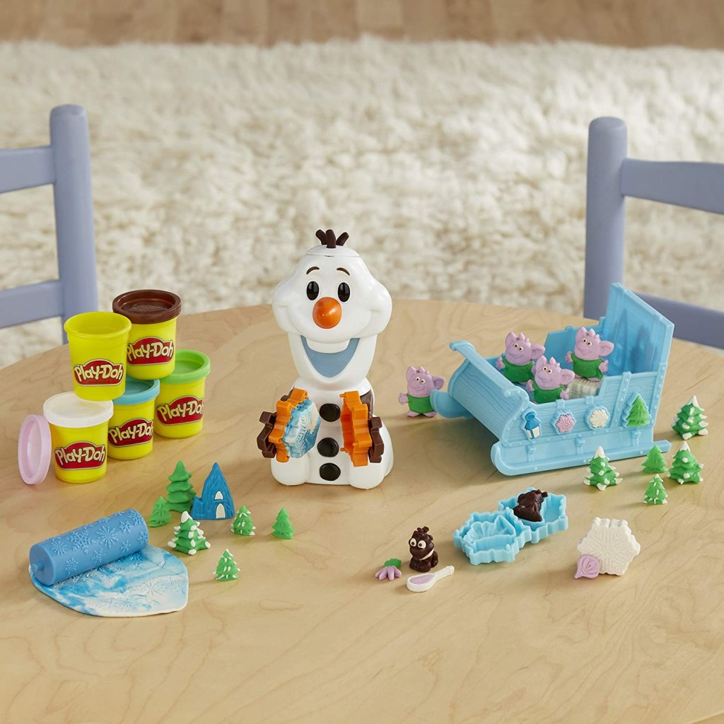 Olaf Sleigh Ride PLaydoh set opened with contents on table