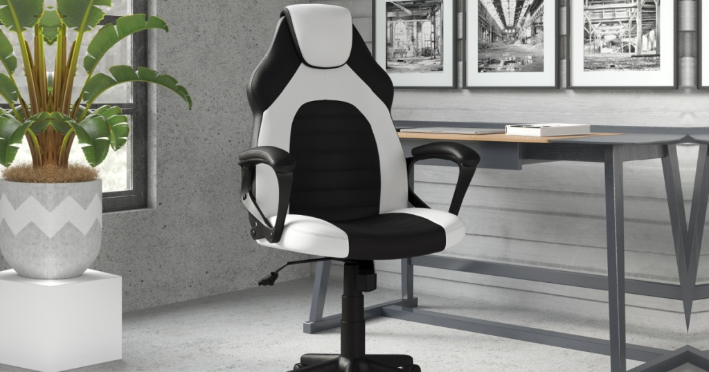 black and white gaming chair in an office next to a desk