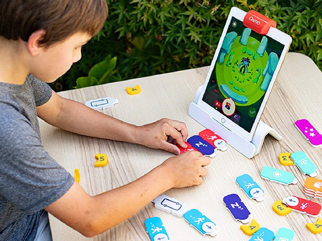 child playing with coding kit