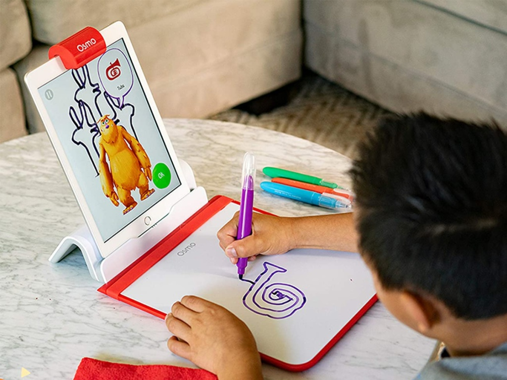 boy playing with Osmo Creative Starter Kit for iPad drawing on pad