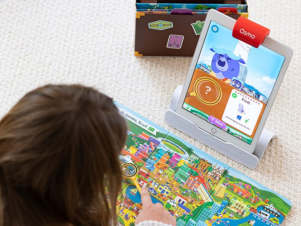 girl playing with osmo detective agency game with ipad