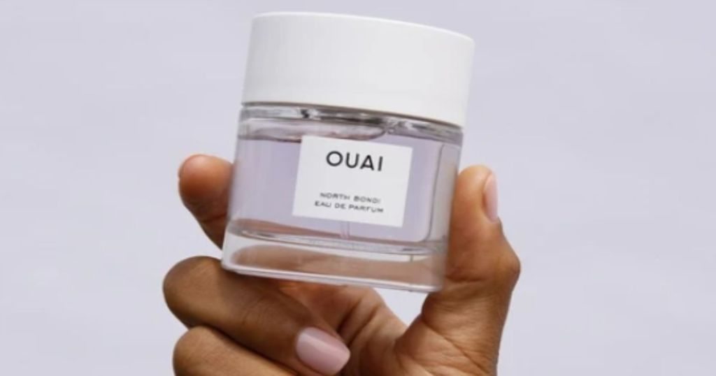ouai north bondi eau dau de parfum fragrance held in a hand