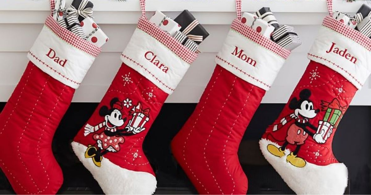red and white quilted Christmas stockings alterating with disney christmas stockings hanging from a mantle