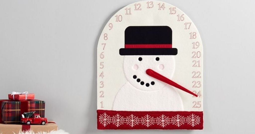 Pottery Barn Kids Silly Snowman Advent Calendar hanging on a wall