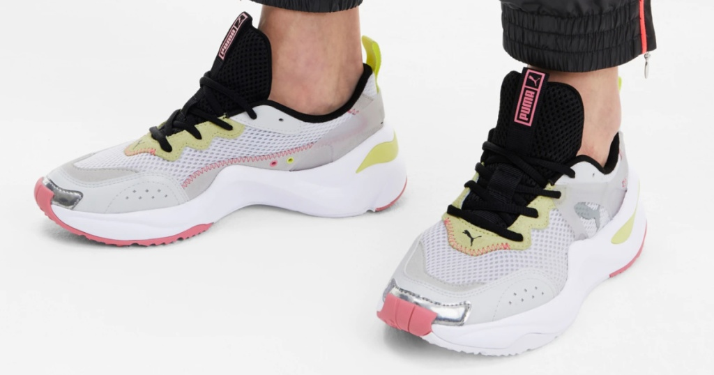 woman wearing puma athletic shoes