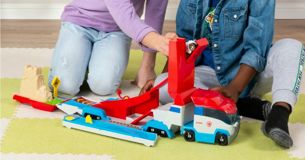 boy and girl playing with Paw Patrol Rescue Truck
