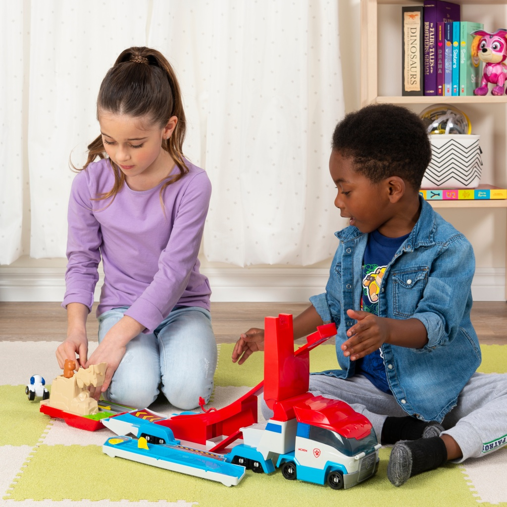 Paw Patroller Truck on play mat with kids
