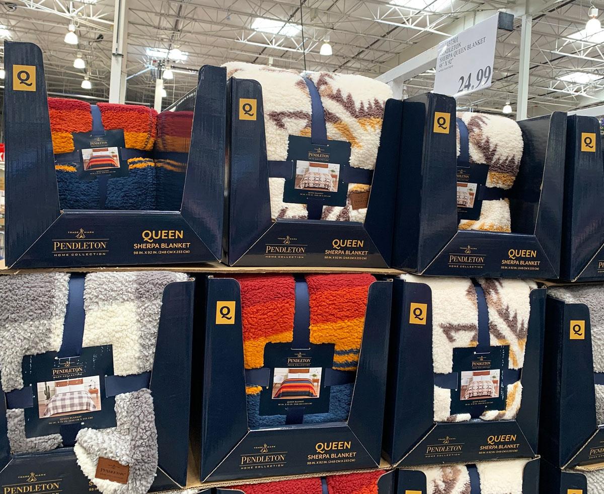 sherpa blankets in cardboard costco display cases