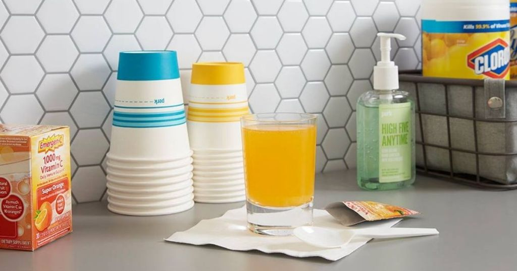 kitchen counter with cups, juice and hand sanitizer