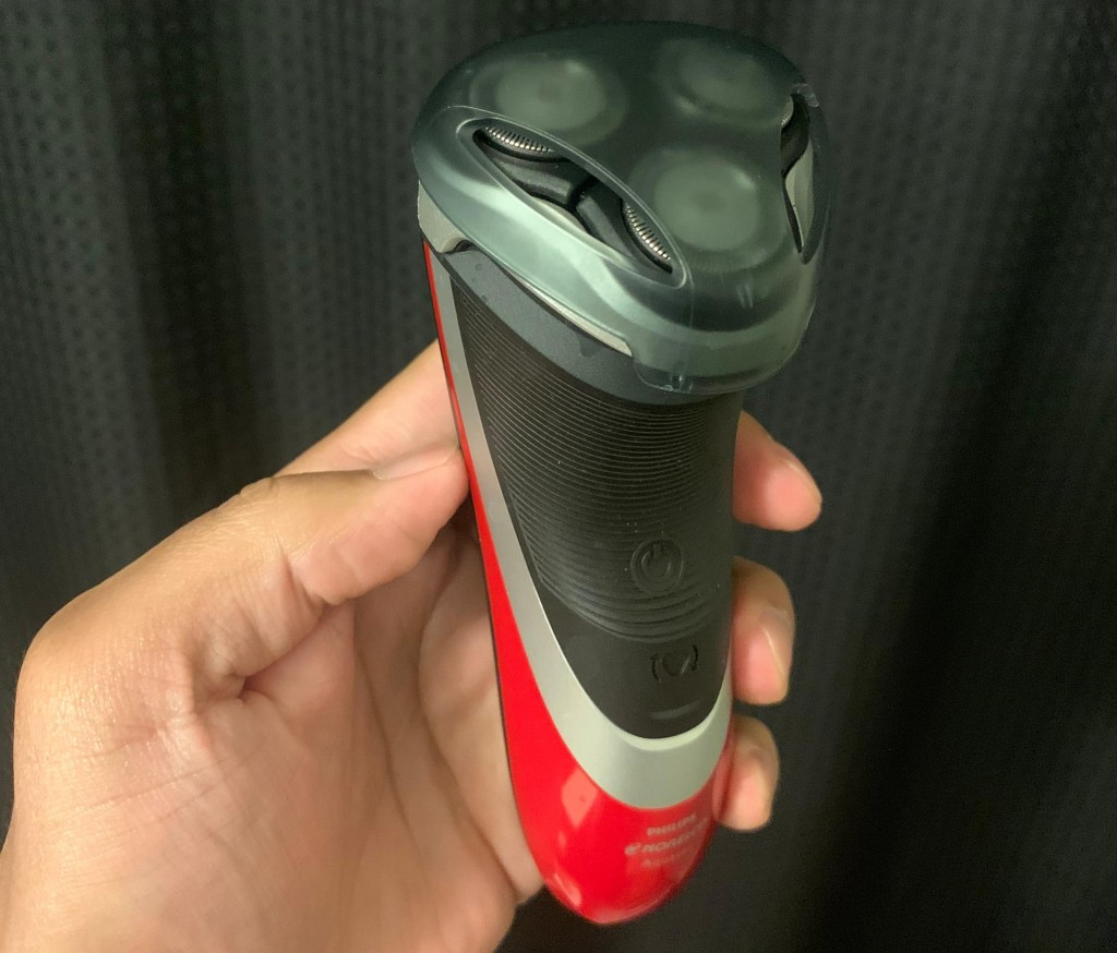 hand holding a Philips Norelco razor