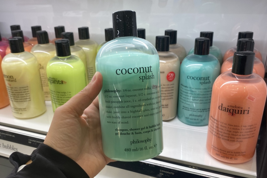 hand holding philosophy shower gel at macys