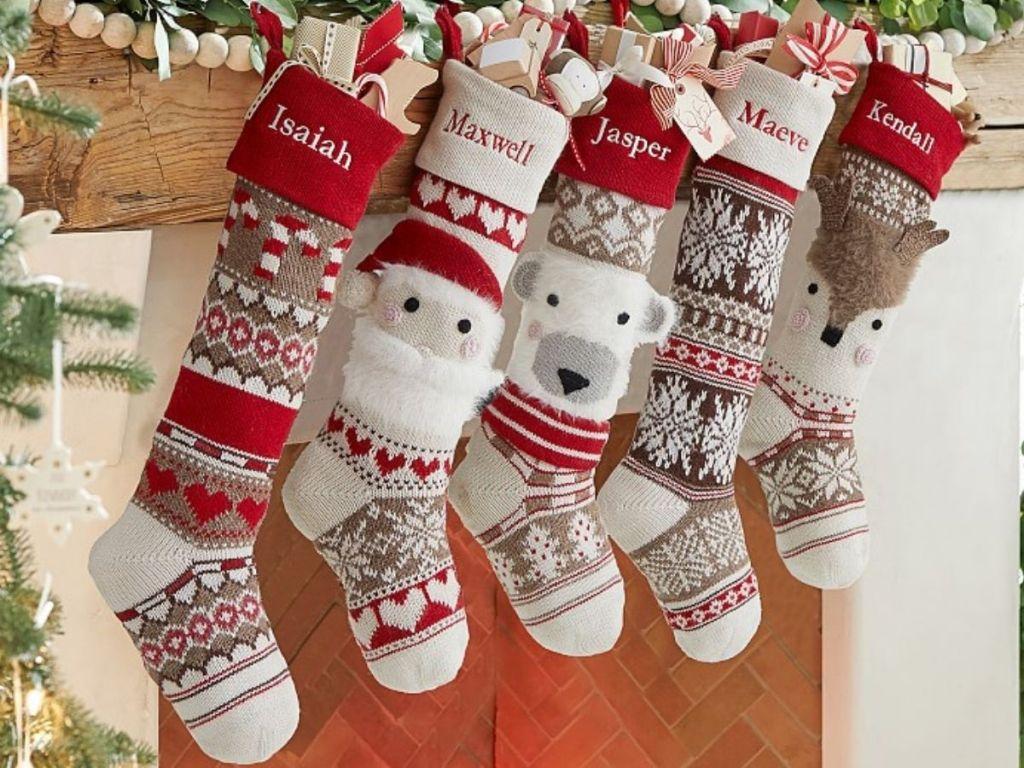 Pottery Barn Fair Isle Christmas Stockings hanging on mantle