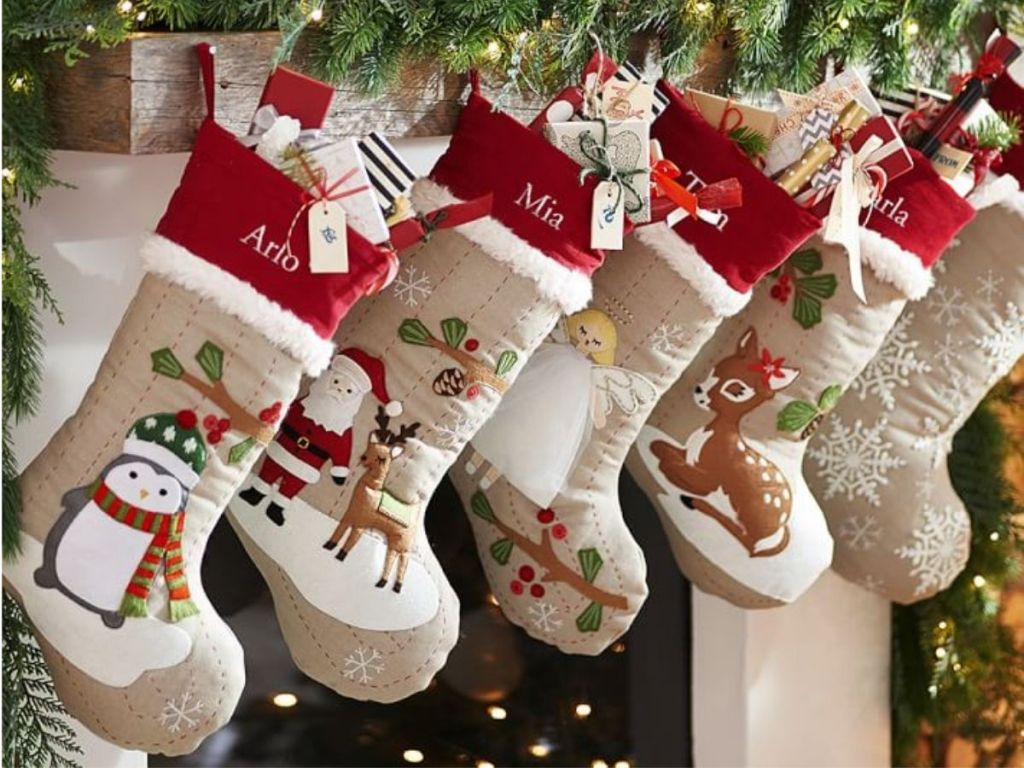 Pottery Barn Christmas Stockings hanging from mantle