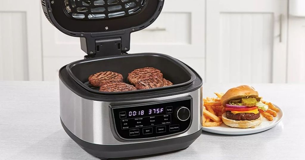 Power XL Air Fryer Grill with burgers inside and a plate with a burger next to it