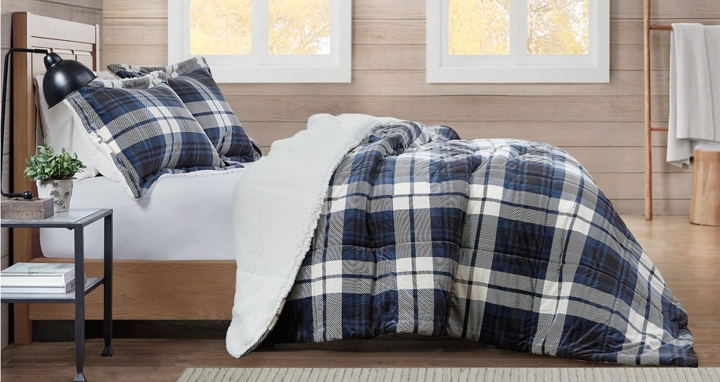bedroom with a bed and plaid comforter
