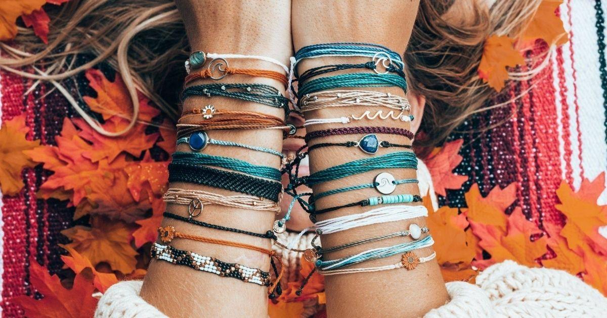 woman wearing multiple bracelets