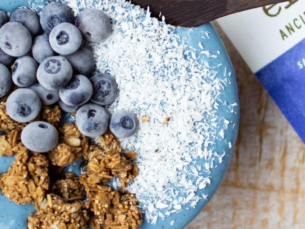 blue smoothie with fresh blueberries and granola