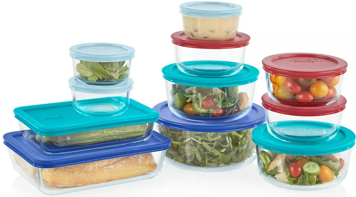 Pyrex brand containers in an assortment of sizes with food inside