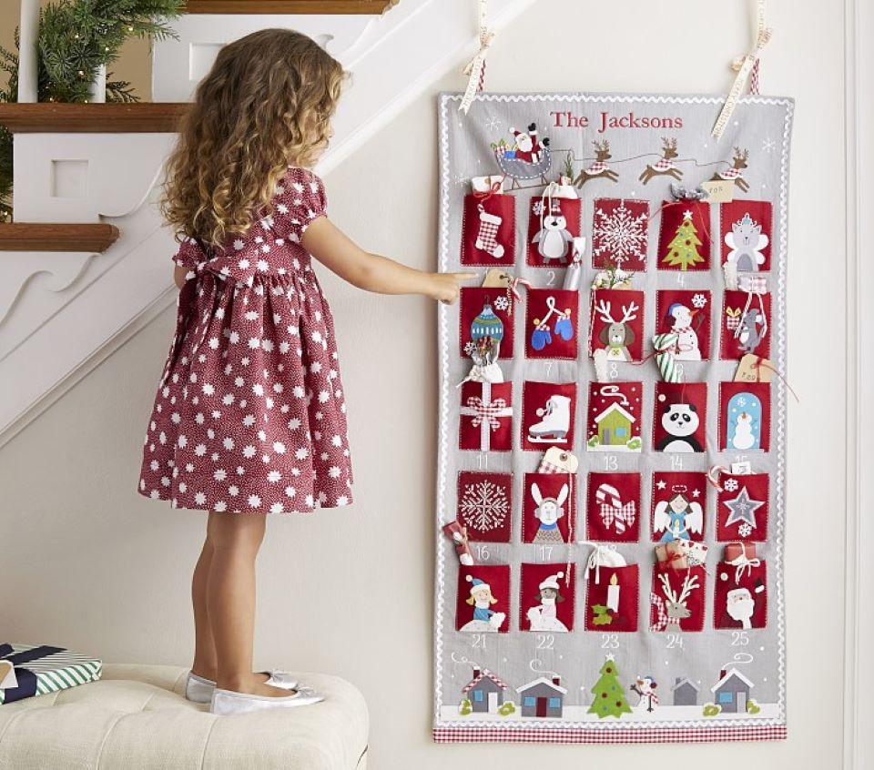 girl playing an advent calendar