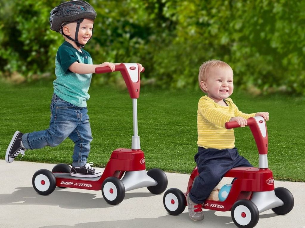 Two Boys Riding Radio Flyer Ride n Scoot Toys