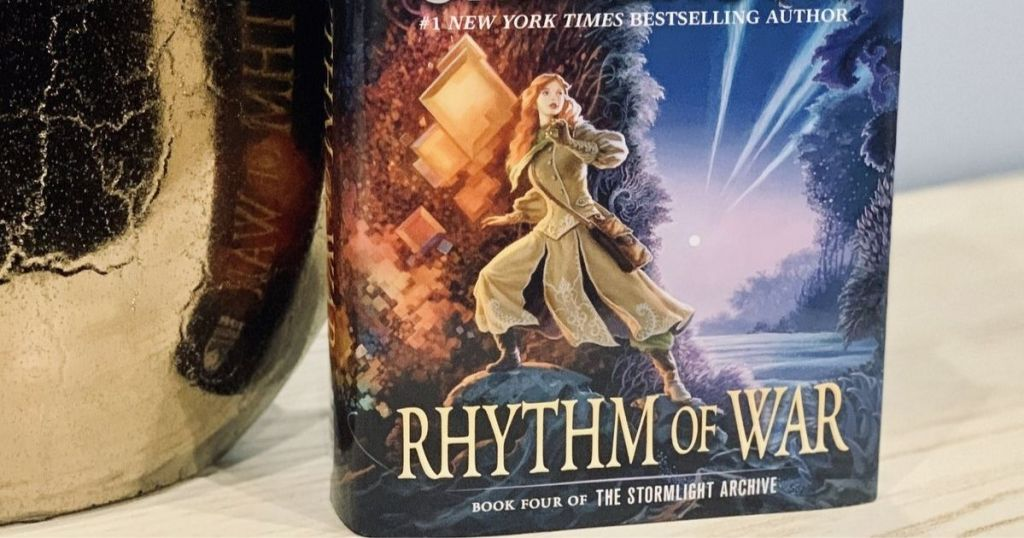 Rhythm of War on table with vase