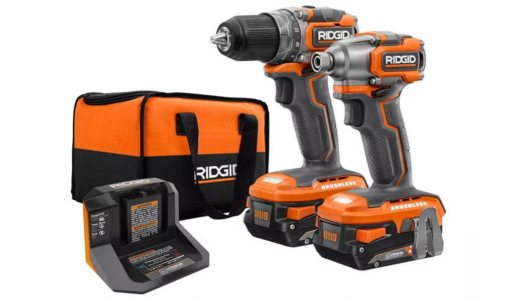 black and orange ridgid cordless brushless drill/driver, impact driver, a charger, and a Ridgid tool bag